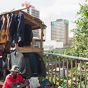 INDIVIDUAL(S) PHOTOGRAPHED: N/A. LOCATION: Lusaka, Zambia. CAPTION: A man sells coats from a market stall in downtown Lusaka.