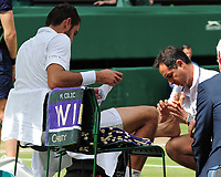 Tennis - 2017 Wimbledon Championships - Week Two, Sunday [Day Thirteen]<br /> <br /> Men Doubles Final match<br /> <br /> Marin Cilic (CRO) vs Rodger Federer (SUI)<br /> <br /> Marin Cilic receives attention to his feet from the Doctor on  Centre court <br /> <br /> COLORSPORT/ANDREW COWIE