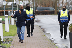 © Licensed to London News Pictures. 16/02/2021. London, UK. Security guards shadow a man who is walking for exercise during quarantine at a  Holiday Inn hotel near Heathrow Airport. People entering the UK from a 'red list' of 33 high risk countries will have to quarantine at hotels for 10 days to try and stop new coronavirus variants entering the country. Photo credit: Peter Macdiarmid/LNP