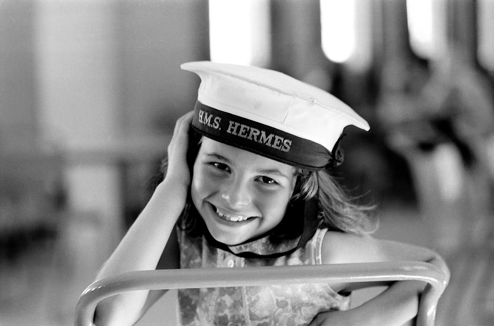 Cyprus War 20 July–18 August 1974. Turkish invasion of Cyprus code-name by Turkey, Operation Attila. British and German holiday makers shelter from Turkish air attacks and shelling in an underground garage below flats  in Kyrenia. A young girl wears a sailors hat from HMS Hermes July 1974. Photo by Terry Fincher.