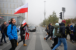 November 10, 2018 - Warsaw, Poland - A woman seen holding a Polish flag as she walks past the Palace of Culture and Science building on her arrival for the Centenary Independence celebrations. (Credit Image: © Omar Marques/SOPA Images via ZUMA Wire)