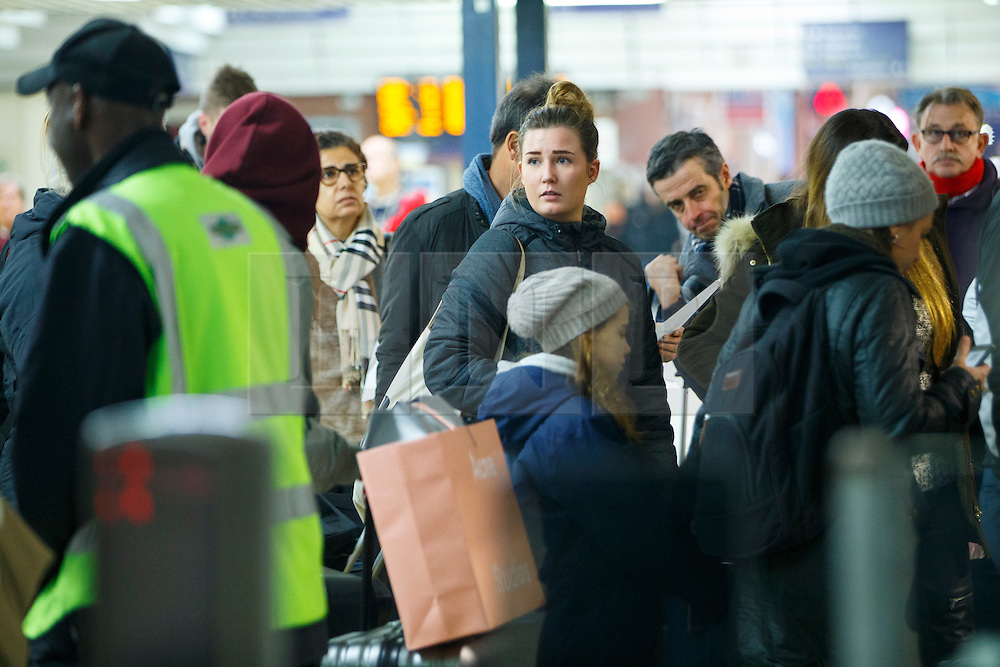 © Licensed to London News Pictures. 06/12/2016. London, UK. Southern Rail passengers wait for the delayed and cancelled trains to arrive at Victoria Station in London on 6 December 2016, as hundreds of thousands of rail passengers face a days of travel chaos because of a 72-hour strike in an escalating dispute over the role of conductors between Southern Rail and the RMT Union. Photo credit: Tolga Akmen/LNP
