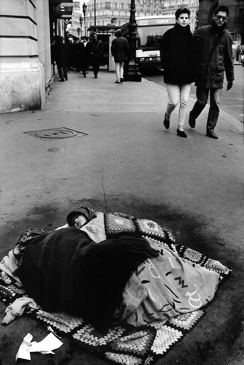 Woman and baby sleeping rough on the streets of Paris, France.
