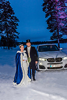 A newlywed Norwegian bride and groom arrive at their wedding reception on a cold winter evening in Trysil, Norway.