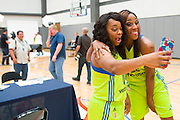 Odyssey Sims and Glory Johnson of the Dallas Wings take a selfie during the team media day in Arlington, Texas on May 5, 2016.  (Cooper Neill for The New York Times)