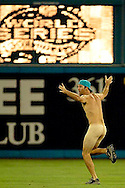 """2003 World Series-A """"Streaker"""" races across the field between inning during Game 5 of the 2003 World Series between the Florida Marlins and New York Yankees. (Photo by Ron Vesely/MLB Photos)."""