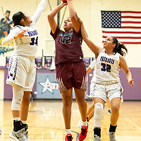Photo: Jeffery Jones<br /> <br /> Shiprock Lady Chieftain Evette Lansing (42) ) takes a shot at the basket while Miyamura Lady Patriots Katianna Toledo (32)) and Tatum Bennett (34) try to defend against her Thursday night at Miyamura High School in Gallup. The Lady Chieftains won 49-36.