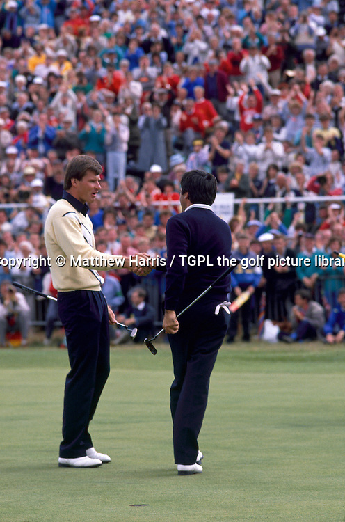 Seve BALLESTEROS (SPN) wins his fifth and final Major as he shakes hands with playing partner Nick FALDO (ENG) during fourth round The Open Championship 1988, Royal Lytham St.Annes,Lytham St.Annes,Lancs.
