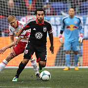 Dwayne De Rosario, D.C. United, is challenged by Markus Holgersson, New York Red Bulls,  in action during the New York Red Bulls V D.C. United, Major League Soccer regular season match at Red Bull Arena, Harrison, New Jersey. USA. 16th March 2013. Photo Tim Clayton
