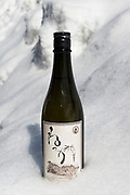 A bottle of shochu, Nekka Shochu Distillery, Tadami, Fukushima, Japan, February 22, 2018. The Nekka shochu distillery was founded in July 2016 and at that time was the smallest shochu distillery in Japan. It makes shochu from locally-grown rice, and is helping support a local economy that has languished since the nuclear disaster of 2011.