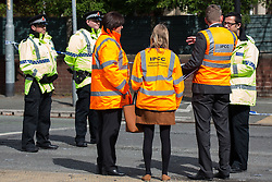 © Licensed to London News Pictures . 27/04/2016 . Manchester , UK . Staff from the ipcc ( Independent Police Complaints Commission ) at the scene . Scene where police report two died in a fatal RTA involving a white Audi A5 at 03:15 this morning (Weds 27th April) . Greater Manchester Police report they observed the vehicle shortly before it crashed in to street furniture on Wilbraham Road in Chorlton, close to Whalley Range High School For Girls . Photo credit : Joel Goodman/LNP