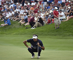 June 24, 2018 - Cromwell, CT, USA - Bubba Watson lines up his birdie putt on the 18th green during the final round of the Travelers Championship at TPC River Highlands in Cromwell, Conn., on Sunday, June 24, 2018. (Credit Image: © Brad Horrigan/TNS via ZUMA Wire)