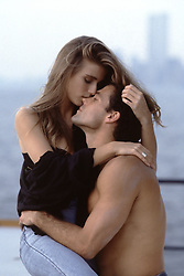sexy couple embracing on a boat in The Hudson River