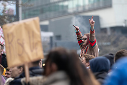 © Licensed to London News Pictures. 06/12/2020. Manchester, UK. A girl waves her arms in time to a performer at Piccadilly Gardens during a Rise Up protest in Manchester. Photo credit: Kerry Elsworth/LNP
