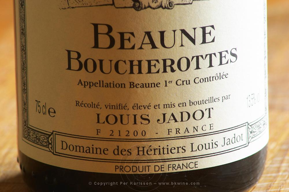 Closeup close-up of a wine bottle label Maison Domaine des Heritiers Louis Jadot Bourgogne Beaune Boucherottes Premier 1er Cru Appellation Controlee, Maison Louis Jadot, Beaune Côte Cote d Or Bourgogne Burgundy Burgundian France French Europe European