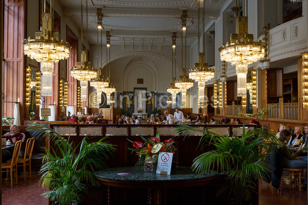 The Art Nouveau interior of Kavarna Obecni dum cafe, on 18th March, 2018, in Prague, the Czech Republic. The Secession-era Kavarna Obecni dum is deservedly considered among the most beautiful cafes in Prague, located on the ground floor of the Municipal House on Náměstí Republiky.