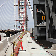 The San Francisco-Oakland Bay Bridge is under construction, and scheduled to open Labor Day 2013. The Self-Anchored Suspension Span (SAS) is the largest bridge of its kind in the world measuring 2,047 feet. This engineering and construction marvel raises the bridge building bar to new heights, as seen in these behind the scenes photos taken on Monday, March 18, 2013. This photo shows the proximity of the new span on the left, with the original span on the right, near the Yerba Buena Island transition. (AP Photo/Alex Menendez)