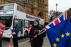 """A Leave Means Leave campaign Bus carrying the slogan """"Believe In Britain"""" and """"Stop the Brexit Betrayal"""" passes Leave and Remain protesters outside Parliament. London, January 07 2019."""