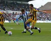 Photo: Andrew Unwin.<br />Hartlepool United v Port Vale. Coca Cola League 1. 06/05/2006.<br />Hartlepool's Joel Porter (C) goes down under a challenge from Port Vale's Jeff Smith (R) but no penalty is given.