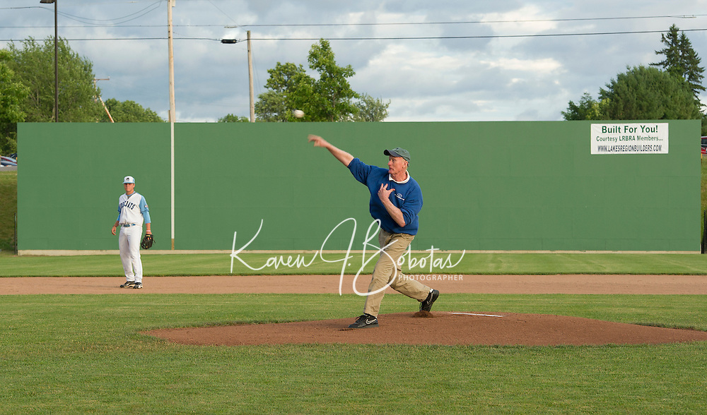 Larry Greeley of Lakes Region Home Builders throws out the first pitch Wednesday evening for the Muskrats game at Robbie Mills Sports Complex.  (Karen Bobotas/for the Laconia Daily Sun)