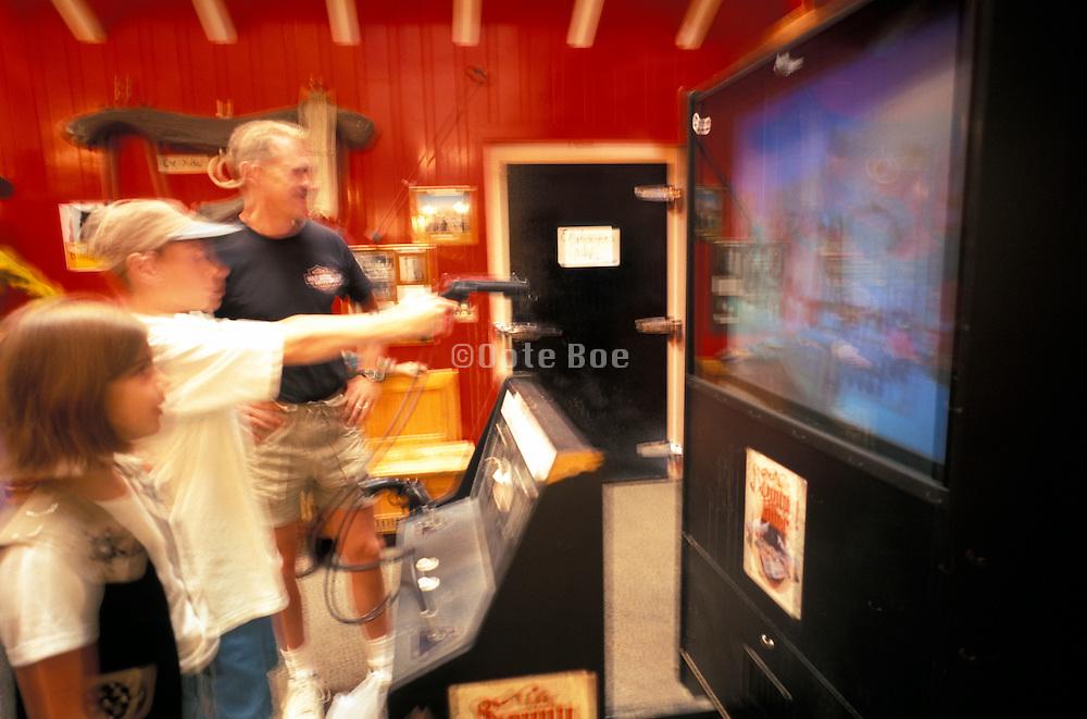 Boy playing an arcade game