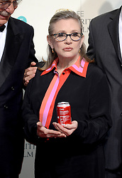 File photo dated 2/14/16 of Carrie Fisher, who has died at age 60