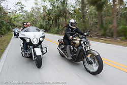 Klock Werks Karlee Kobb on her custom Indian Scout (R) with Brian Klock and Vanessa Nay on their Limited Edition Jack Daniels Indian Chieftain that Brian designed during Daytona Beach Bike Week. FL. USA. Monday March 13, 2017. Photography ©2017 Michael Lichter.