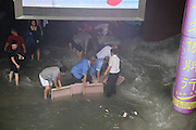 BEIJING, CHINA - JULY 20: <br /> <br /> Citizens protect subway station from floodwater on July 20, 2016 in Tianjin, China. Tianjin Meteorological Observatory has issued an orange alert to heavy rainfall at 08:07 am early Wednesday and the rainstorm is predicted to continue in following six hours.<br /> ©Exclusivepix Media