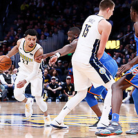 09 November 2017: Denver Nuggets guard Jamal Murray (27) drives past Oklahoma City Thunder guard Raymond Felton (2) on a screen set by Denver Nuggets center Nikola Jokic (15) during the Denver Nuggets 102-94 victory over the Oklahoma City Thunder, at the Pepsi Center, Denver, Colorado, USA.