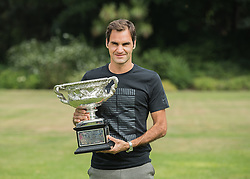 MELBOURNE, Jan. 29, 2018  Roger Federer of Switzerland poses with his Australian Open trophy, the Norman Brookes Challenge Cup at the Government House in Melbourne, Australia, Jan. 29, 2018. (Credit Image: © Zhu Hongye/Xinhua via ZUMA Wire)