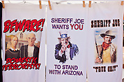 12 JUNE 2010 - Tee shirts with the likeness of Maricopa County Sheriff Joe Arpaio for sale at a rally in support of SB 1070 in Phoenix, AZ. About 500 people, many from California and Florida, came to Bolin Memorial Park in Phoenix Saturday. The pro SB 1070 rally was sponsored by Tea Party.   PHOTO BY JACK KURTZ