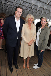 HRH The DUCHESS OF CORNWALL and children TOM PARKER BOWLES and LAURA LOPES at a party to celebrate the publication on 'Let's Eat: Recipes From My Kitchen Notebook' by Tom Parker Bowles held at Selfridge's Rooftop. Selfridge's, Oxford Street, London on 27th June 2012.