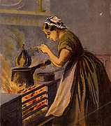 Cook putting a suet pudding wrapped in a cloth in a saucepan of hot water to boil on a typical small kitchen range. Kronheim chromolithograph from a children's book published London c1885.