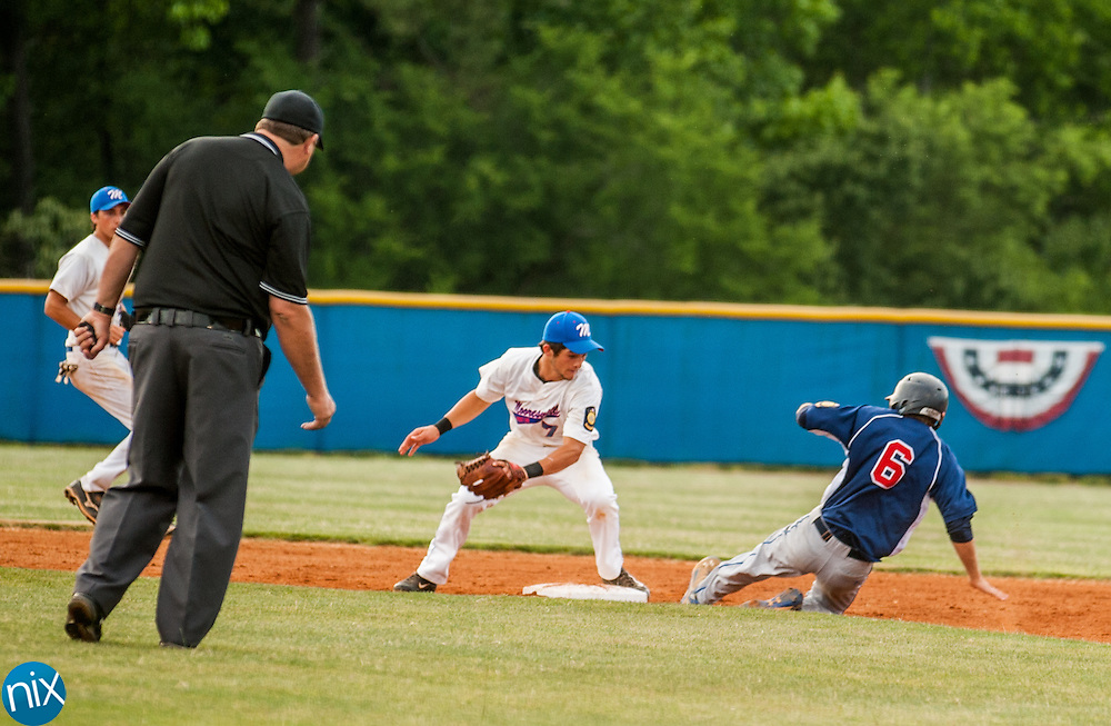 Concord Post 51's Brett Barrier steals second base against Mooresville Post 66 Monday night at Lake Norman High School. Concord won the game 6-5.