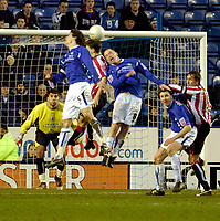 Photo: Leigh Quinnell.<br /> Leicester City v Southampton. The FA Cup. 28/01/2006.<br /> Leicesters Iain Hume and Patrick McCarthy can't find a way to the Southampton goal.