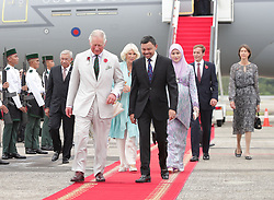 The Prince of Wales (left) and the Duchess of Cornwall are accompanied by His Royal Highness Prince Haji Al-Muhtadee Billah, the Crown Prince of Brunei, and his wife Sarah (third right), Crown Princess of Brunei upon arriving in Brunei during an 11-day autumn tour of Asia.