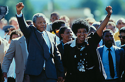 Feb 11, 1990 - Cape Town, South Africa - Anti-apartheid fighter NELSON MANDELA with his wife WINNIE walks out of Victor Verster Prison a free man after 26 years of imprisonment. He was awarded the Nobel Peace Prize Dec 10, 1993. (Credit Image: Allen Tannenbaum/ZUMAPRESS.com)