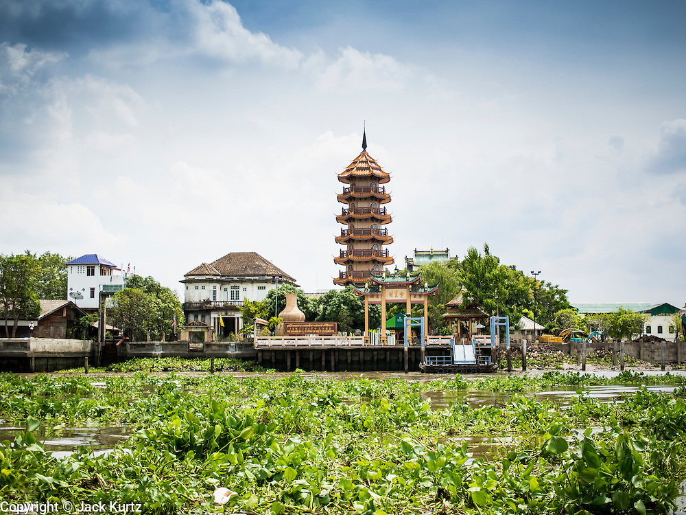 26 AUGUST 2014 - BANGKOK, THAILAND:  The eight level pagoda at the Chee Chin Khor temple in Bangkok. Chee Chin Khor Moral Up-Lifting for Benefiction Foundation in a Chinese style temple on the Thonburi side of the Chao Phraya River in Bangkok. It blends aspects of Taoism, Buddhism (both Theravada and Mahayana), Islam, and Christianity religious traditions. Members of the temple perform community services throughout Bangkok.       PHOTO BY JACK KURTZ