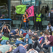Hundreds of climate changes protest a sit in (Don't Pat the GLA) at City Hall, Inspired by Imogen May, a brave activist from Devon who refused to pay her council tax, we are planning to withhold the portion of our council tax that funds the GLA on 18 July 2019, London, UK.