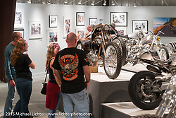 """Checking out Paul Cox's 1925 Harley-Davidson JD in Michael Lichter's Motorcycles as Art annual exhibition titled """"The Naked Truth"""" at the Buffalo Chip Gallery during the 75th Annual Sturgis Black Hills Motorcycle Rally.  SD, USA.  August 4, 2015.  Photography ©2015 Michael Lichter."""