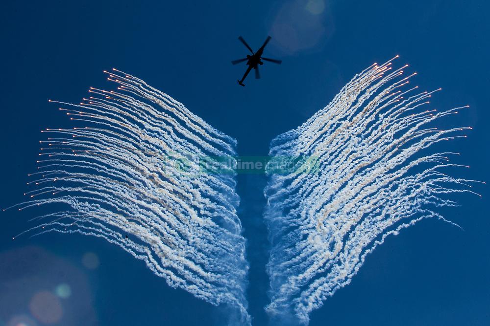 June 4, 2017 - Saint Petersburg, Russia - MI-28N helicopter of aerobatic team Berkuts fly during an air show marking 75th anniversary of 6th air force army of Russia in St. Petersburg, Russia, Sunday, June 4, 2017. (Credit Image: © Igor Russak/NurPhoto via ZUMA Press)