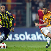 Galatasaray's Milan BAROS (R) and Fenerbahce's Cristian Oliveira BARONI (L) during their Turkish superleague soccer derby match Galatasaray between Fenerbahce at the Turk Telekom Arena in Istanbul Turkey on Friday, 18 March 2011. Photo by TURKPIX
