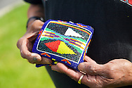 Yakama National Cultural Center Gift Shop features hand made Yakama handwork.  A gentleman shows off his hand-made, beaded wallet, a gift from his sister.