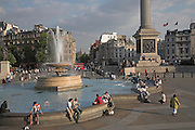 People sitting by fountain, Trafalgar Square, London, England Fountain,