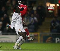 Photo: Paul Thomas.<br /> Blackburn Rovers v Basle. UEFA Cup. 02/11/2006.<br /> <br /> Blackburn's Shabani Nonda (Red) has a great shot a goal past Papa Malick BA, but is saved by the Basel keeper.