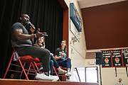 Isaiah Johnson, who plays George Washington for Hamilton in San Francisco, speaks with students at Rancho Middle School in Milpitas, California, on May 24, 2017. (Stan Olszewski/SOSKIphoto)