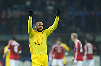 Football - UEFA Champions League  - AC Milan vs. Arsenal<br /> Arsenal's Thierry Henry waves goodbye to the travelling Arsenal fans at the end of his last game for the club, at the San Siro Stadium, Milan