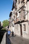 Historic buildings on Carrera del Darro by the Rio Darro river, Granada, Spain