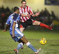 Photo: Pete Lorence.<br />Lincoln City v Wycombe Wanderers. Coca Cola League 2. 30/12/2006.<br />Kevin Betsy tries to send the ball past Jeff Hughes.
