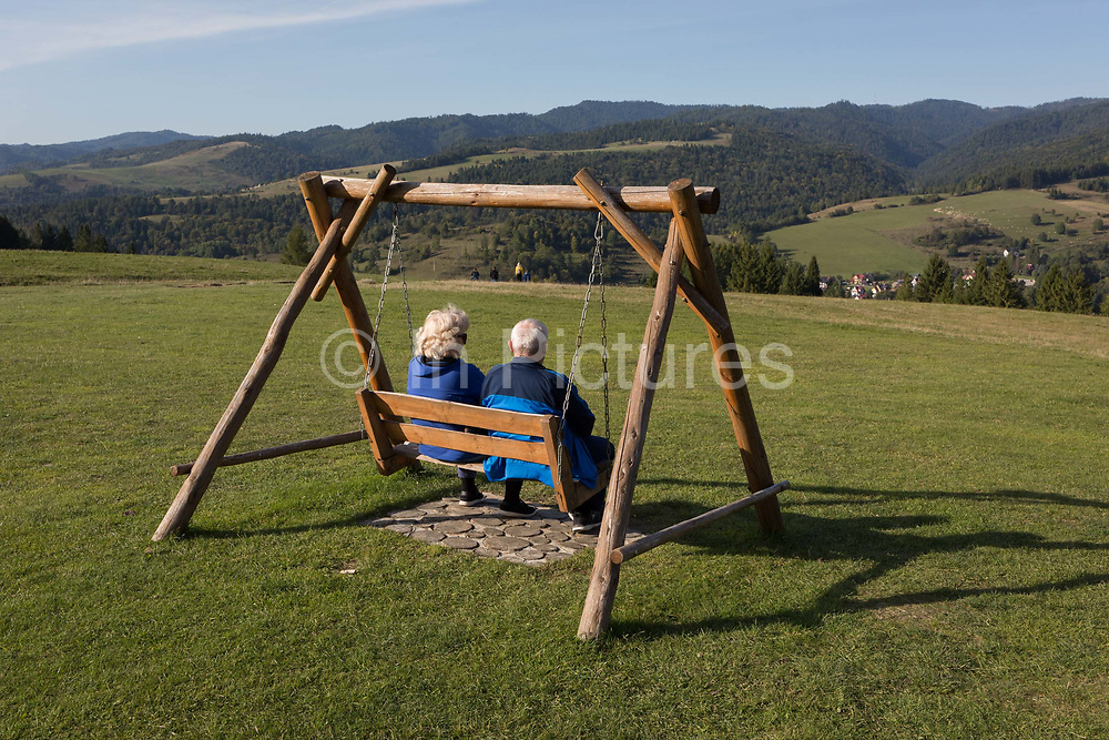 From the viewpoint of the hillside chairlift, a grass meadow landscape, Polish visitors look down on the Polish village of Jaworki, on 21st September 2019, in Jaworki, near Szczawnica, Malopolska, Poland.
